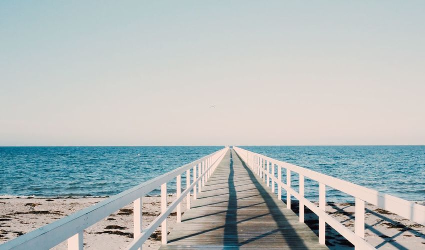 Sea Horizon Over Water Water Nature Clear Sky Scenics Beach Beauty In Nature Railing Tranquility Pier No People Outdoors Day Sky Bluesky Blue Sea Blue Sky Jetty View Tranquility Clear Sky Railing Jetty, Pier Pier Boardwalk