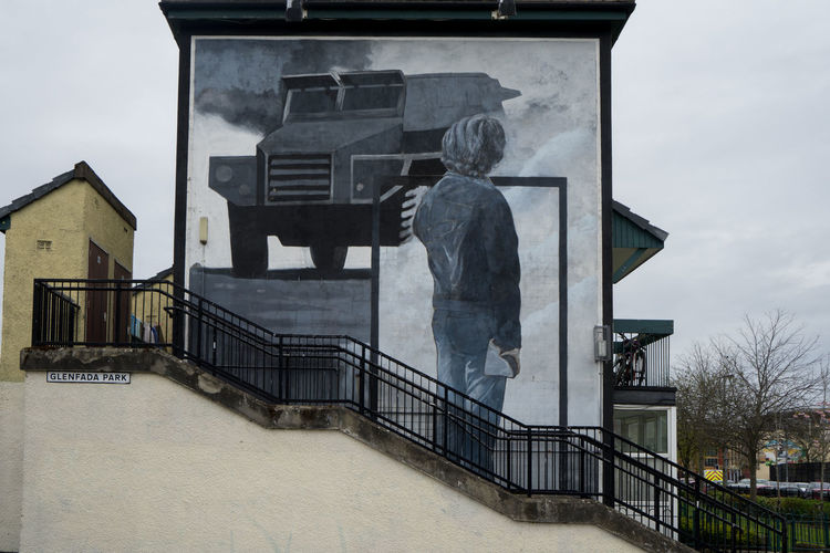 Architecture Building Exterior Built Structure Cloud - Sky Day Derry Human Representation Ireland Irish Londonderry Low Angle View Male Likeness Mural Art No People Northern Ireland Outdoors Railing Sculpture Sky Statue Wallart