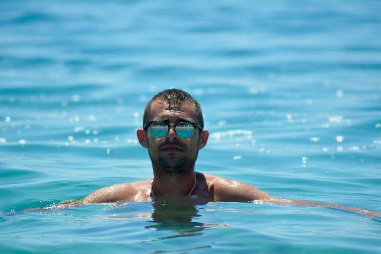Portrait of man swimming in sea