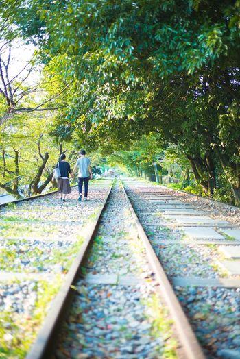 People walking on railroad track