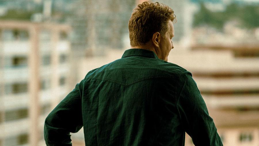 Rear view of man looking at city