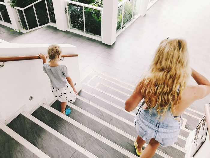 High angle view of sisters on steps