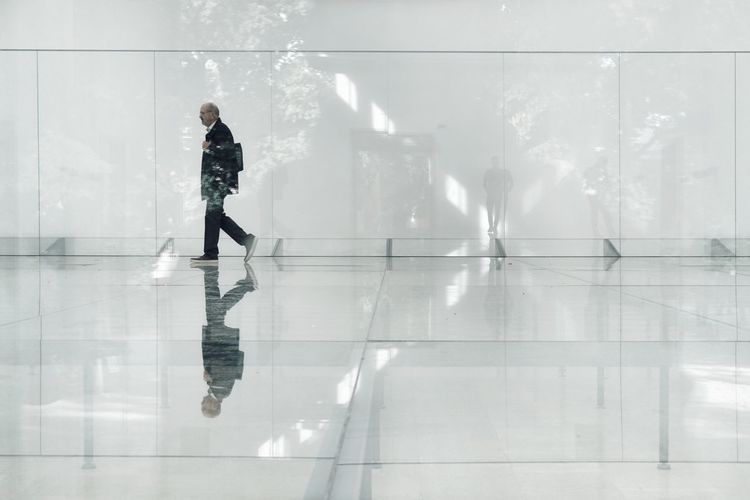 Reflection of man standing in water