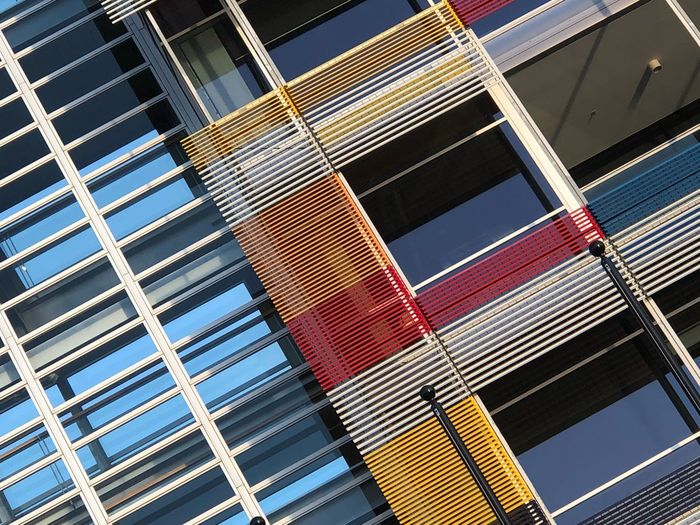 Lines Contrast Abstract Vibrant Color Colorful Yellow Red Parallel In A Row Design EyeEm Selects Architecture Building Exterior No People Built Structure Building Pattern Modern Glass - Material Outdoors Low Angle View Backgrounds Metal Office Building Exterior Design Reflection City Day Sunlight