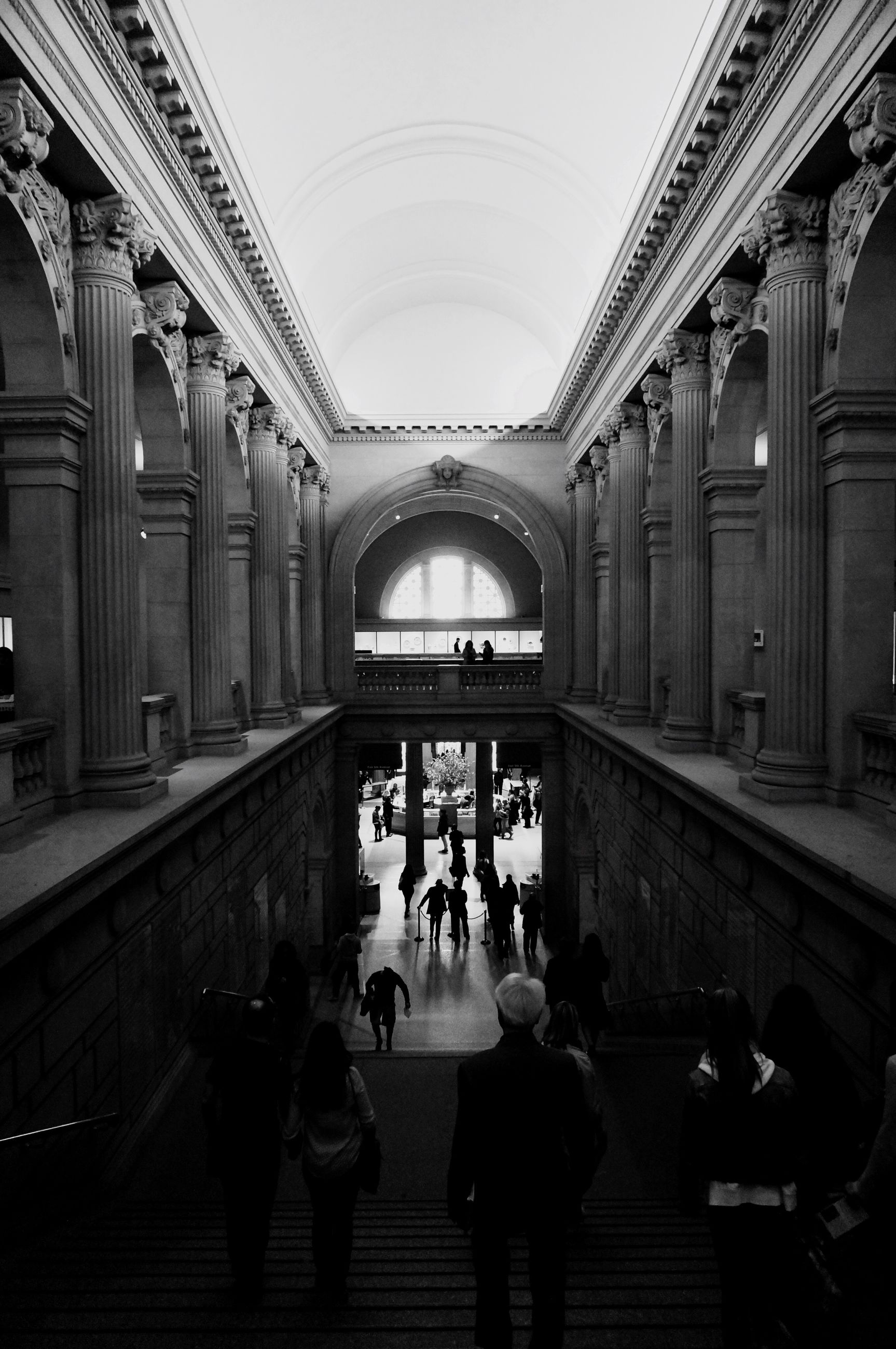 indoors, architecture, men, built structure, person, lifestyles, arch, large group of people, ceiling, leisure activity, walking, travel, architectural column, full length, railroad station, famous place, travel destinations, corridor, group of people