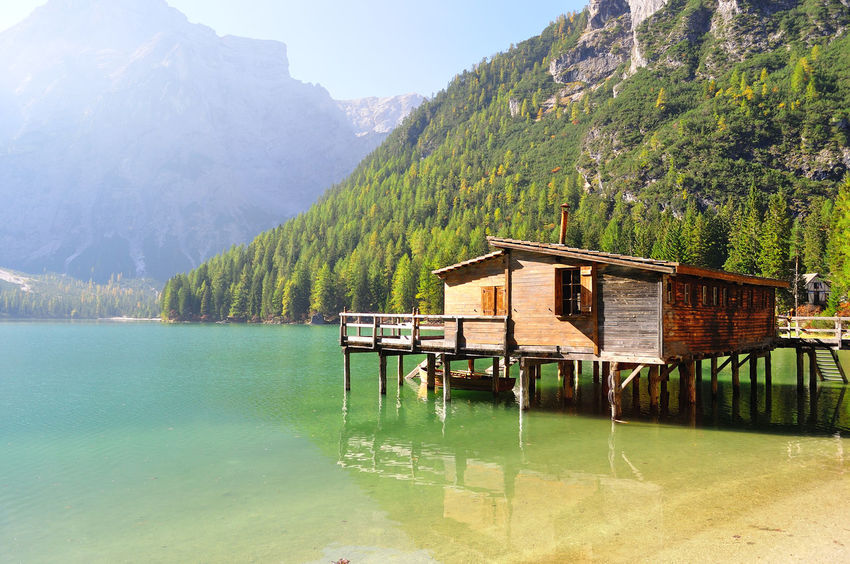 Alps Green Color Harvest Season Hut Lake Mountain Nature No People Outdoors Reflections Sea Touristic Destination Tranquility Water Yellow Color