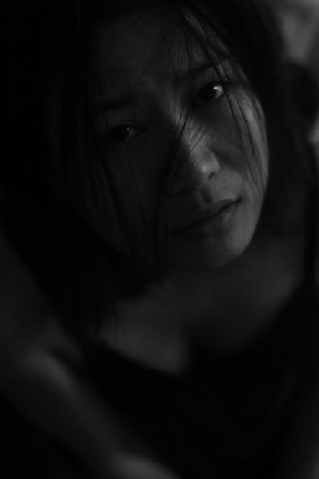 Close-Up Portrait Of Depressed Young Woman At Home