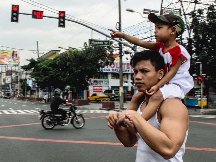 Eyeem Philippines This Is Masculinity Bicycle City Day Kalabasa Photography Leisure Activity Lifestyles Outdoors Point And Shoot Real People Street Photography Streetphoto_color Streetphotography Togetherness Transportation Tree Two People Young Adult Young Men
