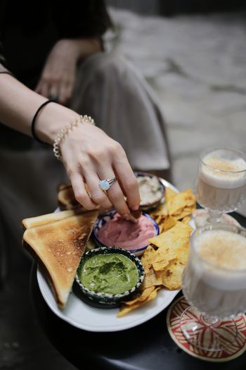 Midsection of woman having food in plate