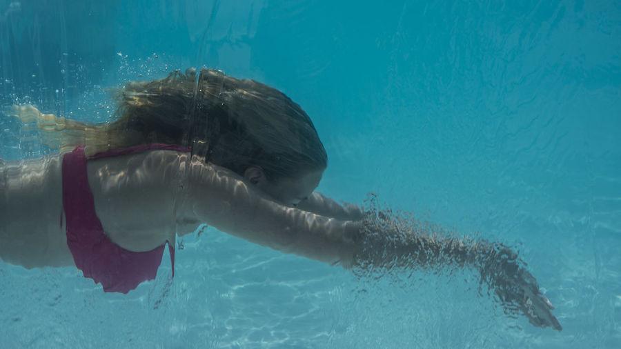 Young woman swimming in sea