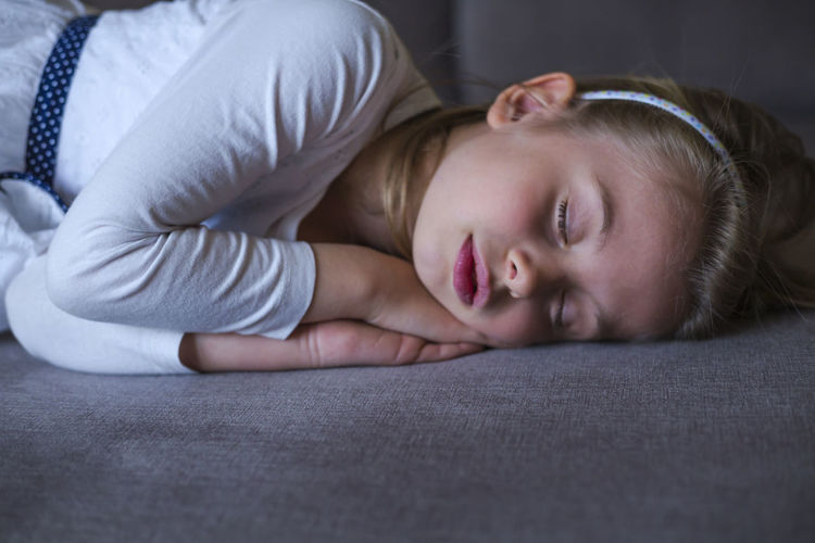 One Person Lying Down Furniture Relaxation Bed Indoors  Childhood Women Child Lifestyles Portrait Resting Real People Home Interior Blond Hair Headshot Front View Leisure Activity Contemplation Beautiful Woman Innocence