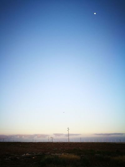Beach Nature Sky Outdoors Clear Sky Beauty In Nature No People Technology Day Airplane Half Moon Beauty In Nature Clear Sky Low Angle View Moon Drivingshot Roadside Shots Rural Scene Landscape Las Palmas De Gran Canaria HuaweiP9 Silhouette