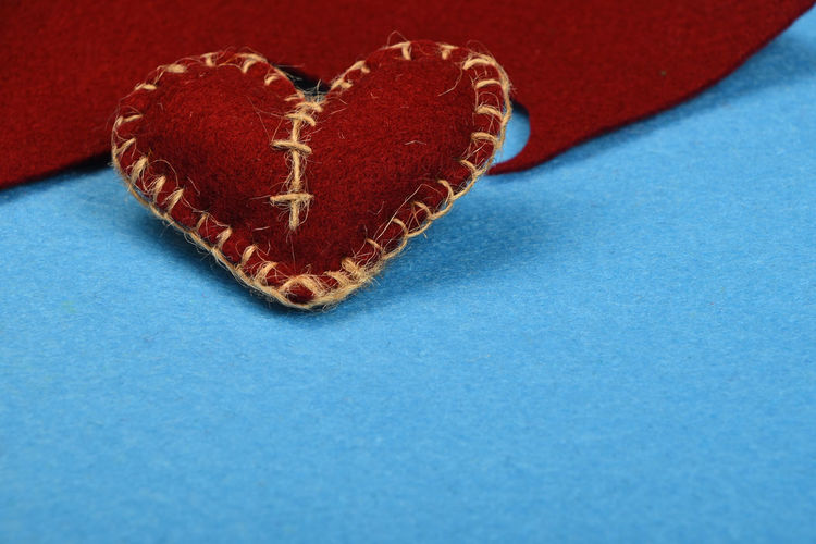 Felt craft, brown stitched heart with twine over blue Art Close-up Color Palette Colorful Colors Colour Of Life Creative Creativity Design Fabric Feelings Felt Felt Craft FeltCraft Gift Handicraft Handmade Heart Love Romance Romantic Textile Valentine Valentine's Day