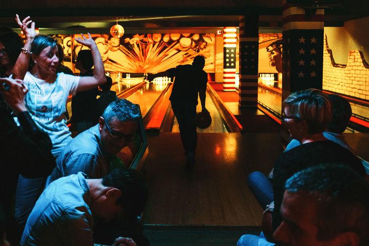 People sitting in illuminated room