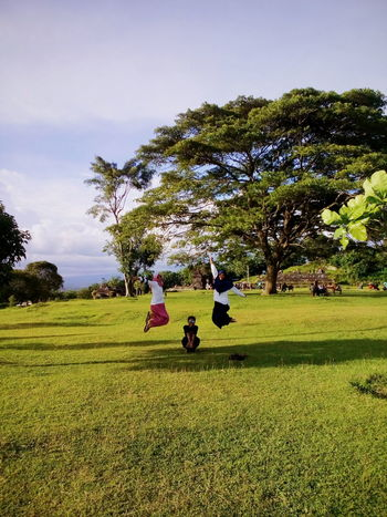 Happy day (Photo by Vina Licorice) Happy Family Love Beautiful Vacations Photography Photographer INDONESIA Love Myself  Love Yourself Field Nature Outdoors Landscape Beauty In Nature Sky Agriculture Tree Grass Freshness