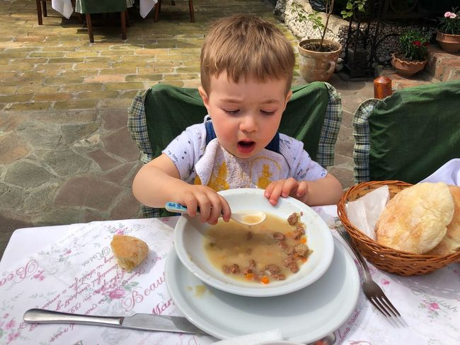 Eat Eating Child Food And Drink Childhood Food One Person Real People Front View Young Babyhood Baby Innocence Eating Utensil Plate Table Lifestyles Sitting Cute Kitchen Utensil