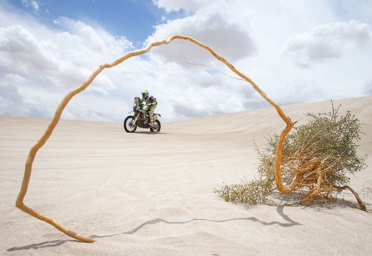 Transportation Desert Sky Scenics - Nature Mode Of Transportation Land Nature Travel Land Vehicle Cloud - Sky Motorcycle Day Environment Landscape Sand Beauty In Nature Climate Real People One Person Leisure Activity Riding Arid Climate Outdoors Dakar