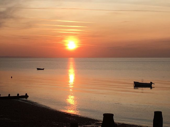 Sunset Water Sea Orange Color Beauty In Nature Nature Scenics Horizon Over Water Sun Tranquility Sky Tranquil Scene Reflection Silhouette Beach Idyllic Nautical Vessel Sunlight Cloud - Sky No People