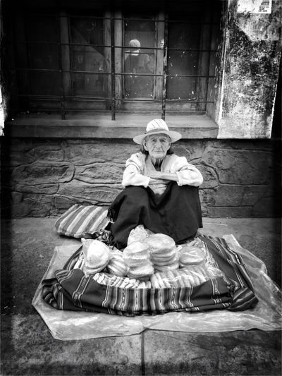 Real People Sitting One Person Outdoors Day People EyeEm Best Edits EyeEm Best Shots - Black + White Bolivia Monochrome Portrait Blackandwhite Streetphotography Street Cochabamba Low Angle View