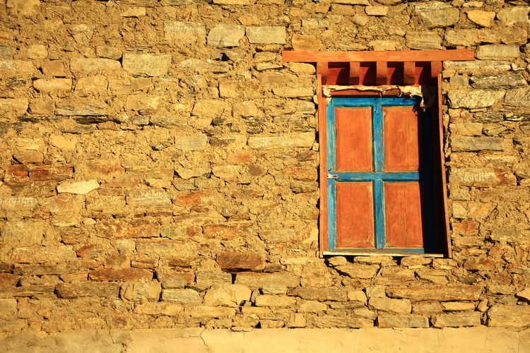 Closed window on wall of building
