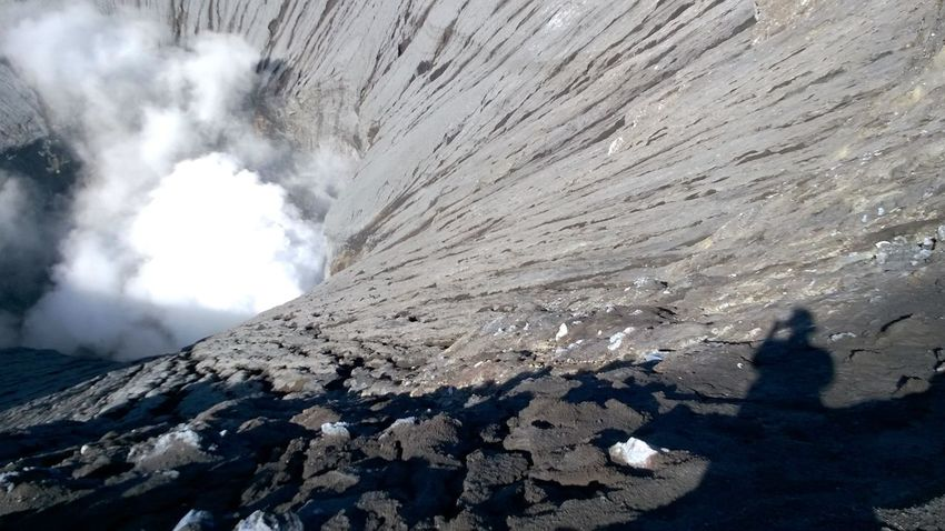 shadow selfie look down at the crater Beauty In Nature Bromo Crater Craters Geology Kawah Kawah Bromo Landscape Low Angle View Mountain Mountain Range Nature Non-urban Scene Physical Geography Rock - Object Rock Formation Scenics Tranquil Scene