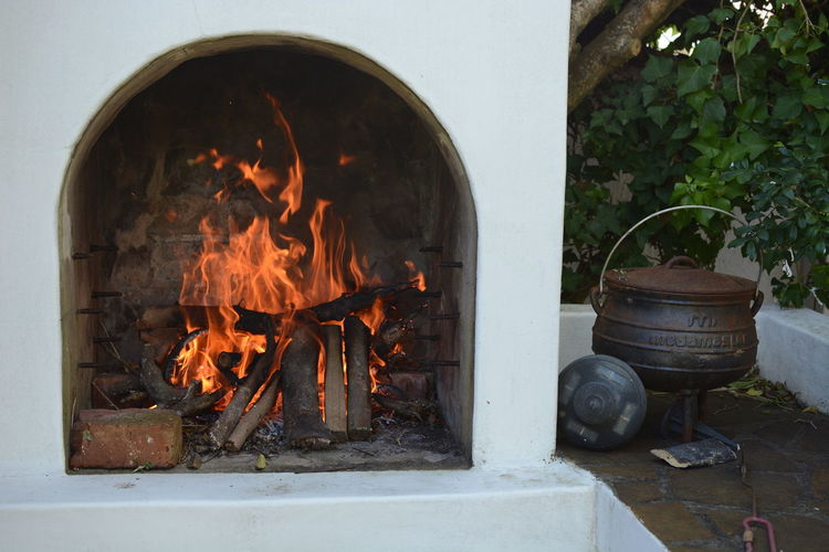 Bad Condition Blaze Broken Burning Destruction Fire Fire - Natural Phenomenon Firewood Flame Heat Heat - Temperature Metal No People Old Potjie Wall