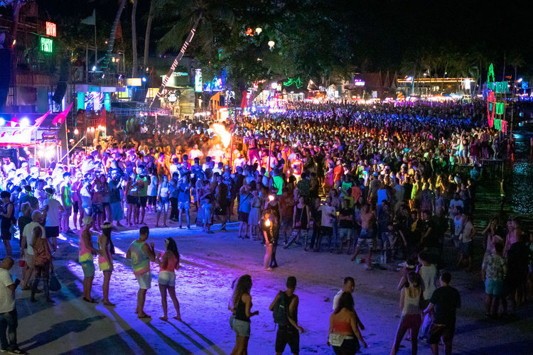 Haad Rin Full Moon Beach, Thailand Crowd Large Group Of People Group Of People Real People Night Illuminated Enjoyment Celebration Outdoors Party Neon Lights Neon Colored Neon Sign Thailand High Angle View Circle Fire Koh Phangan Full Moon Party Palm Trees Beach Leisure Activity Festival Dancing Dance
