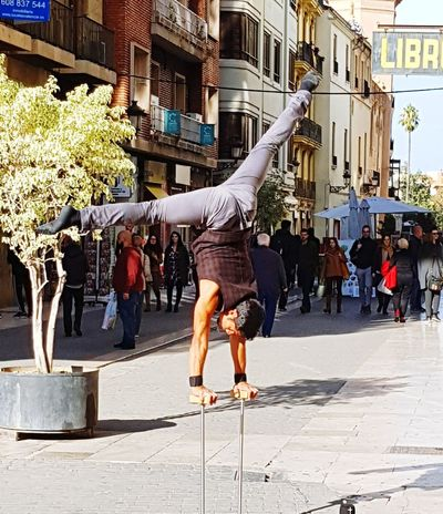 City Full Length City Life Street Architecture Building Exterior Built Structure Breakdancing Hip Hop Street Art City Street Visiting Acrobat Dancer Chain Swing Ride