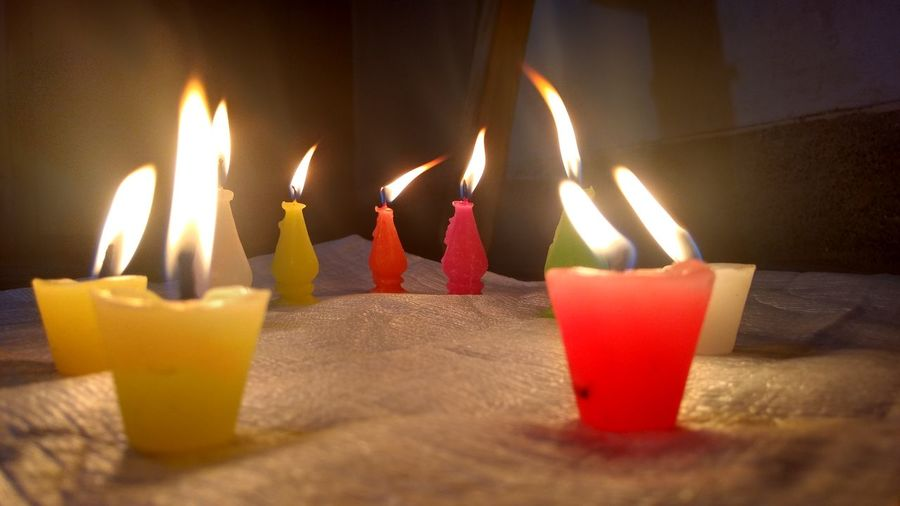 Close-up of lit candles on birthday cake