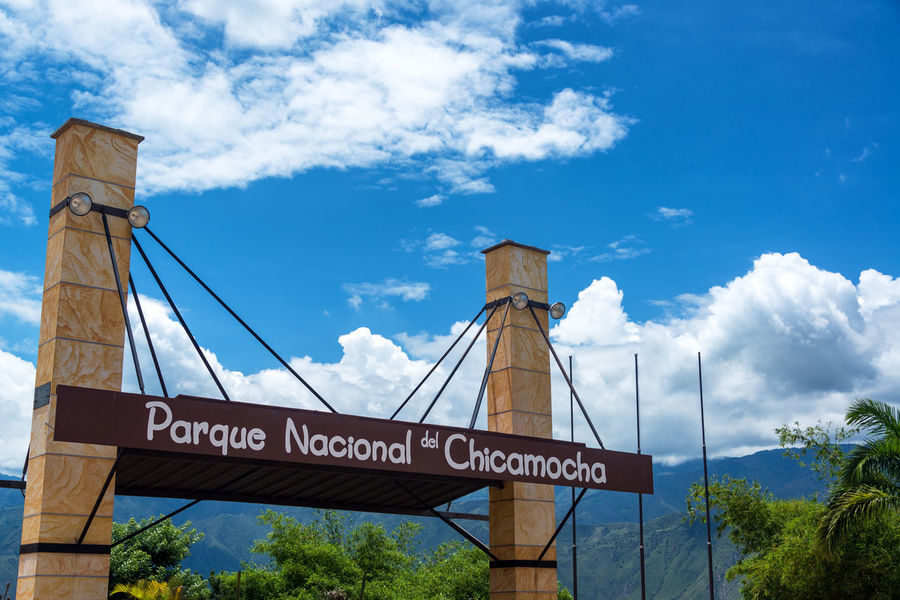 CHICAMOCHA CANYON, COLOMBIA, MAY 8: Sign at the entrance to Chicamocha National Park in Chicamocha Canyon, Colombia on May 8, 2016 Architecture Bucaramanga Canyon Chicamocha Chicamocha Canyon Cloud Cloud - Sky Colombia Day Destination Entrance Landmark Landscape Mountain National Park Outdoors Panachi Park Santander Sign Travel Tree Tree Trees View
