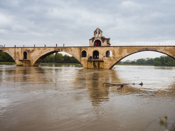 High water in Rhône river with Pont d'Avignon Pont Saint-Bénézet Avignon Cloudy France High Water Pont D'avignon  Provence Rhône TOWNSCAPE Weather Arch Arch Bridge Architecture Bridge Bridge - Man Made Structure Built Structure Extreme Weather Flood No People Outdoors River Riverbank Town Water