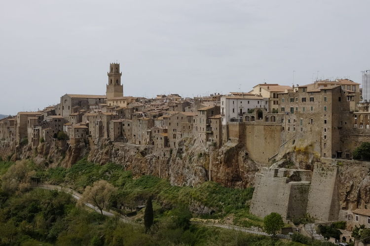 view of the medieval town of Pitigliano Tuscany Architecture Built Structure Building Exterior Sky History Building The Past Nature Ancient Old Travel Destinations No People City Day Travel Old Ruin Tourism Residential District Outdoors Copy Space Ancient Civilization Ruined