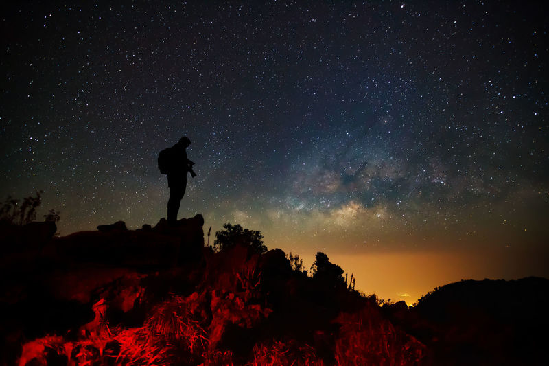 Astronomy Beauty In Nature Full Length Galaxy Landscape Milky Way Mountain Nature Night One Person Outdoors People Real People Rock - Object Scenics Silhouette Sky Star - Space Starry Sunset Tranquil Scene Tranquility