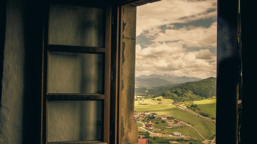 Everyone is always looking Sky Window House Mountain Landscape Built Structure Nature Cloud - Sky No People Indoors  Architecture Day Scenics Beauty In Nature Building Exterior Agriculture Tree The Great Outdoors - 2017 EyeEm Awards