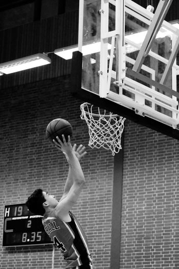 Lay-up Blackandwhite Black And White Basketball Game Basketball Basketball Player Lifestyles Basketball Hoop One Person Sport Basketball - Sport Real People Ball Playing Indoors  Skill  Basketball - Ball Athlete Arms Raised