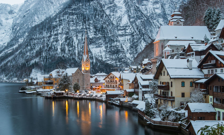 Buildings by lake during winter in hallstatt