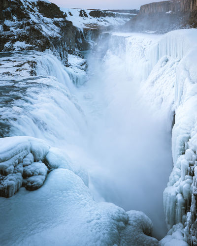 The raw beauty. Check out my prints at https://simonmigaj.com/shop/ and visit my IG http://www.instagram.com/simonmigaj for more inspirational photography from around the world. Waterfall Cold Ice Iceland Travel Extreme Weather Gullfoss Water Raw Power Energy Clean Energy Water Waterfall Cold Temperature Winter Hot Spring Blue Snow Ice Beauty River Glacier Iceberg Iceland Flowing Water Flowing Natural Landmark