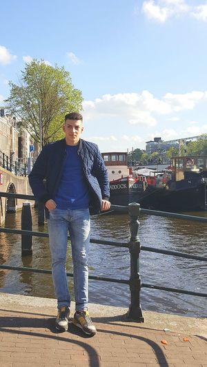 Amsterdam Water Young Adult Front View One Young Man Only Casual Clothing Fashion Portrait Sky Cloud - Sky One Person Adult Day People One Man Only Only Men Full Length Adults Only Outdoors First Eyeem Photo