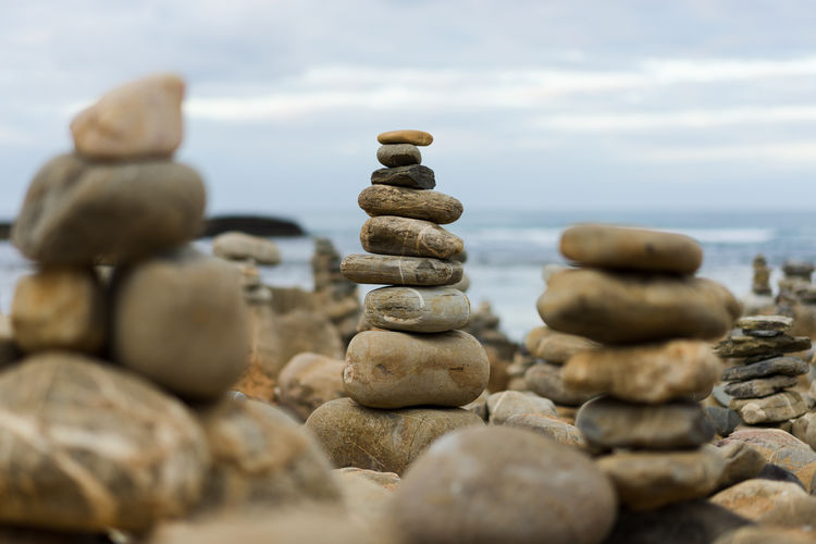 Stack Balance Stone - Object Pebble Zen-like Solid Rock No People Large Group Of Objects Stone Selective Focus Close-up Beach Land Rock - Object Tranquility Nature Outdoors Sky Vila Nova De Milfontes Portugal