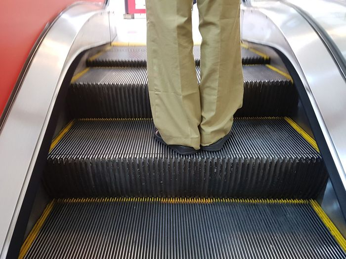 People Low Section Adult Escalator In Service. Man Male Legs Body Part Standing