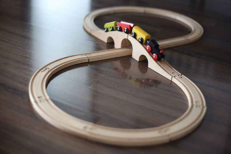 Close-up of train set on wooden table at home