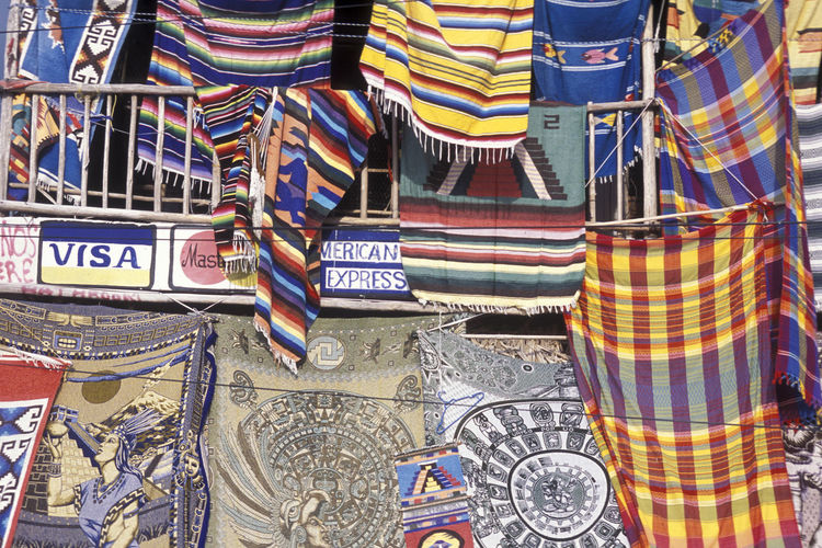 Full frame shot of multi colored textiles hanging at store