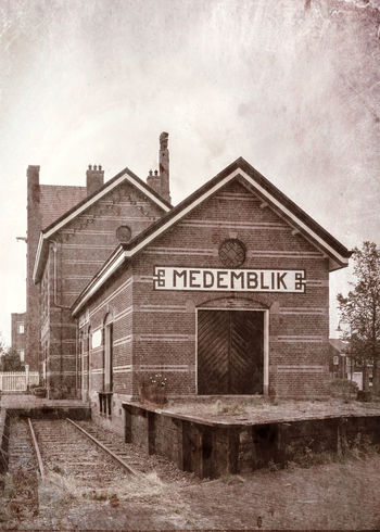 Old trainstation in the small town Medemblik, Netherlands. Text Built Structure No People Architecture Train Station Old Building Tracks Rails Sign Textured  Day Outdoors Medemblik Monochrome Weed