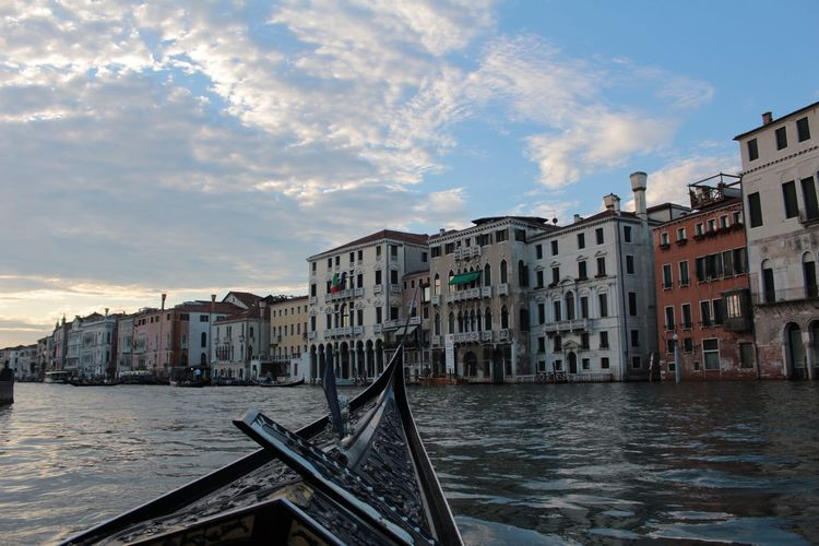 Gondola on grand canal in city