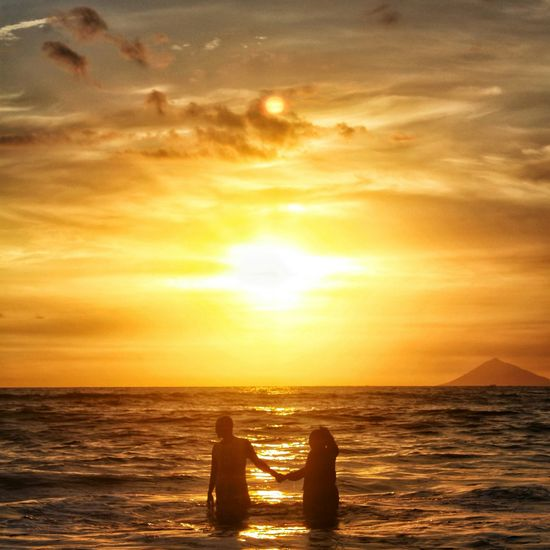 """""""Hold my hand. Don't ever let go. I promise to always stay by your side, just like the sun that never breaks its promise to rise and set."""" Sunset Sunsetporn Sea Beach INDONESIA Wonderful Indonesia First Eyeem Photo"""
