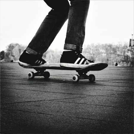 Skating France Streetphotography Blackandwhite Bnw_life City Life People And Places Bordeaux Human Leg Low Section Lifestyles Real People One Person Human Body Part Leisure Activity Roller Skate Skill  Men Day Outdoors Push Scooter Close-up