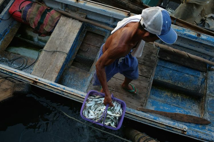 High angle view of fisherman on boat