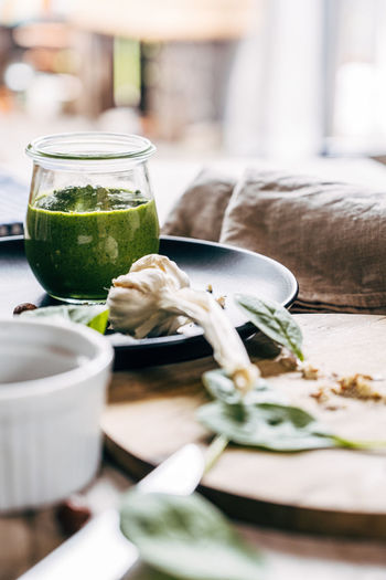 Close-up of green pesto sauce served in glass on table