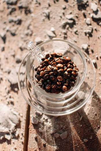 Food And Drink Food Jar High Angle View Container Glass - Material Freshness No People Wellbeing Healthy Eating Close-up Brown Indoors  Seed Roasted Coffee Bean Focus On Foreground Still Life Wood - Material Transparent Table Glass