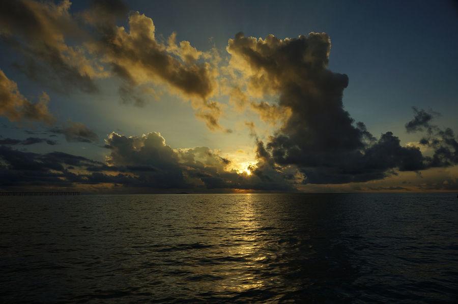 rising sunrise on the horizon, blue sea, ocean (sea) at Semporna Sabah Malaysia Atmosphere Atmospheric Mood Beauty In Nature Cloud Cloud - Sky Cloudscape Cloudy Dramatic Sky Light Majestic Moody Sky Orange Color Outdoors Scenics Sea Semporna Silhouette Sky Storm Cloud Sun SUN RICE Sunset Tranquil Scene
